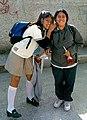 Two Mexican schoolgirls smiling.jpg