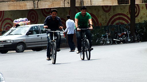 Two bicyclist in Shahrbani sq - Kashmar