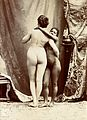 Two women posing naked in a photographic studio, standing em Wellcome V0048565EL.jpg