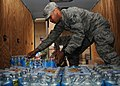 U.S. Air Force Senior Airman Mitchell Chandler, an aircrew flight equipment journeyman with the 931st Operations Support Squadron, loads bottled water into a truck at McConnell Air Force Base, Kan., May 21 130521-F-EP111-043.jpg