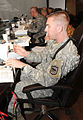 U.S. Army Capt. Regan Norgaard, a medical operations officer with the 196th Maneuver Enhancement Brigade, South Dakota Army National Guard, holds a cotton swab during a familiarization class for the sexual 100815-A-GY802-016.jpg