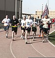 U.S. Army Lt. Gen. Jeffrey Talley, center, the chief of the Army Reserve, participates in a 5K run to mark the component's 105th anniversary at Camp Arifjan, Kuwait, April 23, 2013 130423-A-KU062-170.jpg