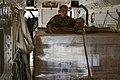 U.S. Army Sgt. 1st Class Christopher Self, with the 641st Aviation Regiment, pushes a pallet of meals, ready to eat (MREs) to the rear of a C-23 Sherpa aircraft May 23, 2013, in Norman, Okla 130523-Z-TK779-038.jpg