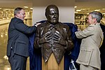 U.S. Deputy Defense Secretary Bob Work, left, and British Chief of Defense Gen. Nick Houghton unveil a bust of Sir Winston Churchill during a ceremony in which Houghton presented the bust to the Defense Departm 150506-D-DT527-106c.jpg