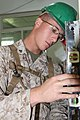 U.S. Marine Corps Lance Cpl. John Toniolo, with the 9th Engineer Support Battalion, 3rd Marine Logistics Group, III Marine Expeditionary Force, checks the level of a new door frame during renovation work 130727-M-DR618-032.jpg