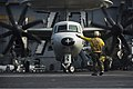 U.S. Navy Boatswain's Mate (Handling) 3rd Class Adrian Ramilo directs the pilots of an E-2C Hawkeye aircraft assigned to Airborne Early Warning Squadron (VAW) 115 on the flight deck of the aircraft carrier USS 131019-N-TX154-449.jpg
