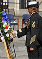 U.S. Navy Fleet Master Chief of Manpower, Personnel, Training and Education April Beldo places a wreath next to The Lone Sailor statue during a Veterans Day ceremony at the U.S. Navy Memorial in Washington 131111-N-ES994-210.jpg