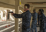 U.S. Navy Information Systems Technician 3rd Class Benjamin Leach, assigned to the amphibious assault ship USS Peleliu (LHA 5), fires at a target during a pistol qualification at Naval Air Station North Island 131008-N-YW024-117.jpg