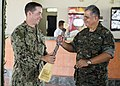 U.S. Navy Lt. Sean Tucker, left, assigned to Coastal Riverine Squadron 2, gives a gift of appreciation to Guatemalan Ship's Capt. Saul Arnoldo Tobar Garcia, the second in command of the Guatemalan Marine 140822-N-XQ474-229.jpg