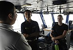 U.S. Navy Midshipman 2nd Class Matt Hendricks, center, from Duke University, and Midshipman 2nd Class Samantha Damon, right, from Oregon State University, tour primary flight control aboard the aircraft carrier 130623-N-IB033-161.jpg