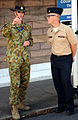 U.S. Navy Musician 3rd Class Hunt Gibson, right, with the U.S. Naval Forces Europe Band, talks with Royal Australian Air Force Flight Sgt. Eden Stubbings during a break from rehearsals for the Royal Edinburgh 120731-N-VT117-1313.jpg