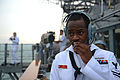 U.S. Navy Operations Specialist 2nd Class Jacolby Davis, assigned to the guided missile cruiser USS Antietam (CG 54), stands lookout watch as the ship arrives in Hong Kong for a port visit Nov. 8, 2013 131108-N-TG831-051.jpg