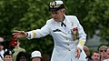 U.S. Navy Rear Adm. Nora W. Tyson, the vice director of the Joint Staff, throws rose petals into the reflecting pond at the Women in Military Service for America Memorial in Arlington, Va., during a Memorial Day 130527-D-KC128-012.jpg