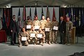 U.S. Soldiers hold their certificates of naturalization as they pose with Robert Daum, left, the deputy district director for U.S. Citizenship and Immigration Services (USCIS) in Bangkok; Pius D. Bannis, second 131111-Z-MH103-171.jpg