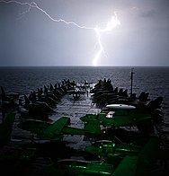 US Navy 021101-N-4309A-003 Lightning strikes light up the bow of USS Abraham Lincoln.jpg