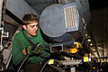 US Navy 030323-N-9403F-168 Photographer's Mate 2nd Class Jacob Lantz from Greely, Co., prepares to fill a Low Altitude Navigational and Targeting Infrared for Night (LANTIRN) pod with oil aboard USS Abraham Lincoln (CVN 72).jpg