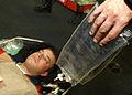US Navy 030710-N-9769P-026 Storekeeper Seaman Jason Hood from Diamond Bar, Calif., simulates an injured person with a chest wound during a mass causality drill aboard USS John C. Stennis (CVN 74).jpg