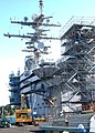 US Navy 030814-N-9605S-003 The flight deck of the USS Abraham Lincoln (CVN 72) is transformed into a construction site during a Planned Incremental Availability.jpg