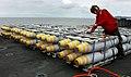 US Navy 031003-N-6213R-333 An Aviation Ordnanceman inspects a pallet of 500-pound BLU-111 penetrator bombs on the flight deck of USS John C. Stennis (CVN 74), during an ammunition onload.jpg