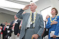 US Navy 031207-N-3228G-013 Pearl Harbor survivor Dr. Rodney T. West joins other invited guests in rendering honors.jpg