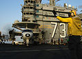 US Navy 040529-N-9630B-025 Aviation Boatswain's Mate 1st Class Floyd Harvell, of Cleveland, Ohio, directs an E-2C Hawkeye assigned to the Bluetails of Carrier Airborne Early Warning Squadron One Two One (VAW-121).jpg