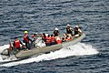US Navy 050429-N-0000X-001 A rigid hull inflatable boat carry survivors rescued from the Gulf of Aden to the coastal patrol ship USS Firebolt (PC 10) after their small vessel capsized 25 miles off the coast of Somalia.jpg