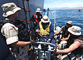 US Navy 050430-N-5526M-012 Sailors aid men and women after their boat, a fishing vessel, capsized 25 miles off the coast of Somalia.jpg