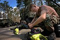 US Navy 050915-N-3879H-001 U.S. Navy Builder 3rd Class Christopher Grisham, foreground, and Builder 3rd Class John Zolovick, both assigned to Naval Mobile Construction Battalion One (NMCB-1), perform maintenance on chainsaws.jpg