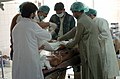 US Navy 051013-N-8796S-208 Pakistani doctors operate on an injured woman at one of the only hospitals left operational in the city of Muzafarabad, Pakistan.jpg