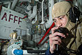 US Navy 051115-N-4321F-026 Damage Control Fireman Duane Cunningham of Hilo, Hawaii, performs a sound-powered telephone check from his general quarters station during a drill.jpg