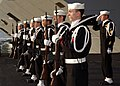 US Navy 060213-N-0685C-002 Sailors assigned to the honor guard detail stand at attention prior to rendering honors during a burial at sea aboard the Nimitz-class aircraft carrier USS Theodore Roosevelt (CVN 71).jpg
