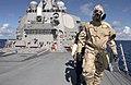 US Navy 060901-N-9851B-002 Hull Technician 3rd Class Marc Brandes wears an Advanced Chemical Protective Garment (ACPG) while leading an external survey team.jpg