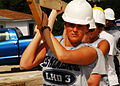 US Navy 070503-N-1831S-106 Information Systems Technician 2nd class Brittany Aubuchon helps carry a roofing frame during a community relations project.jpg