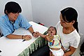 US Navy 070717-N-9421C-015 Cmdr. Con Yee Ling discusses the condition of a baby to his mother at Ngu Hanh Son District Medical Center in Da Nang, Vietnam.jpg