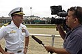 US Navy 070723-N-0555B-265 Capt. Terry Kraft, commanding officer of USS Ronald Reagan (CVN 76), speaks to a reporter from KUSI, a local San Diego news station, at the Del Mar Thouroughbred Club.jpg