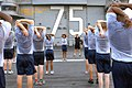 US Navy 070820-N-2699R-569 Cryptologic Technician (Collection) 1st Class Adrienne Taylor leads a group of chief selectees in cool down stretching after an early morning physical training session.jpg