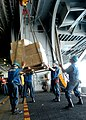US Navy 071029-N-8132M-095 Deck department personnel unload a pallet of supplies from Military Sealift Command fast combat support ship USNS Supply (T-AOE 6) into the hangar bay.jpg