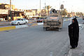 US Navy 071210-M-2819S-060 A woman carries a bag across alternate supply route Ethan.jpg