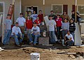 US Navy 080208-N-2564M-118 Sailors stationed aboard the amphibious assault ship USS Wasp (LHD 1) pose for a photograph at the Habitat for Humanity house they worked on as part of a community relations project.jpg