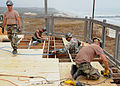 US Navy 080703-N-1424C-798 Seabees assigned to Amphibious Construction Battalion (ACB) 1 reconstruct the deck of a platform overlooking Red Beach.jpg