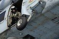 US Navy 081114-N-3659B-062 Naval Aircrewman 2nd Class Jeremy Thomas looks out the door of an SH-60F Sea Hawk.jpg