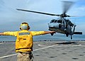 US Navy 081120-N-9134V-009 Boatswain's Mate 2nd Class Cody Rufener directs an SH-60B Sea Hawk.jpg