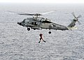 US Navy 090209-N-7571S-002 Explosive Ordnance Disposal Technician 1st Class Bill Pattersons raised into an HH-60H Sea Hawk helicopter.jpg