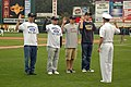 US Navy 090526-N-7975R-011 Cmdr. Curt Jones, commanding officer of Pre-Commissioning Unit (PCU) New York (LPD-21), presides over a swearing-in ceremony at Frontier Field.jpg