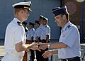 US Navy 090626-N-XXXXG-004 Lt. Abram Stroot, left, receives the Spanish Air Force Safety of Flight trophy from Chief of Staff of the Spanish Armed Forces Gen. Jose Julio Rodriguez Fernandez.jpg