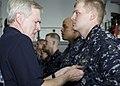 US Navy 090807-N-8655E-099 Secretary of the Navy (SECNAV) Ray Mabus pins the surface warfare officer pin on Ensign Jonathan Smiley, from Columbus, Ohio.jpg