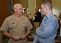 US Navy 091003-N-3283P-030 Rear Adm. Mark Tidd, Deputy Chief of Navy Chaplains and Chaplain of the U.S. Marine Corps, speaks with a Sailor from a religious program team during a visit to Fleet Activities Yokosuka.jpg