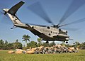 US Navy 100203-N-6214F-076 An MH-53E Sea Dragon helicopter takes off after delivering cots at a medical clinic.jpg