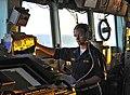 US Navy 100327-N-4774B-370 Ordnance Officer Ensign Trisha Kutkiewicz stands bridge watch aboard USS Bunker Hill (CG 52).jpg