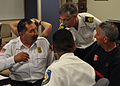 US Navy 100603-N-3158M-002 Naval Station Rota Fire Chief Tim Ybarra, left, talks with American and Spanish firefighting personnel while coordinating a response during a training scenario.jpg